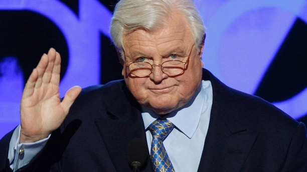 U.S. Senator Ted Kennedy (D-MA) gestures as he addresses the convention after a tribute to his life and career was presented at the 2008 Democratic National Convention in Denver, Colorado, August 25, 2008.