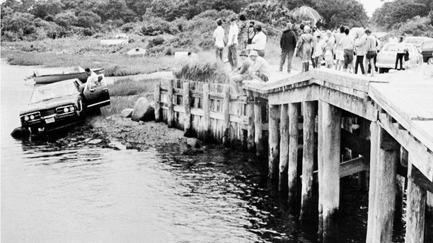 FILE -- In a July 19, 1969 file photo Sen. Edward Kennedy's car is pulled from water as the car is screened off the bridge in Edgartown, Mass. The body of Mary Kopechne of Washington, D.C., was found in rear seat. Her death was attributed to drowning. (AP Photo/file)