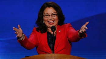 U.S. congressional candidate Tammy Duckworth (D-IL), former Assistant Secretary of the U.S. Department of Veterans Affairs, who lost both of her legs to injuries sustained while serving as a U.S. Army helicopter pilot in combat in Iraq, gestures as she addresses delegates during the first day of the Democratic National Convention in Charlotte, North Carolina, September 4, 2012.    REUTERS/Jason Reed (UNITED STATES  - Tags: POLITICS ELECTIONS)   - TB3E89502DZI4