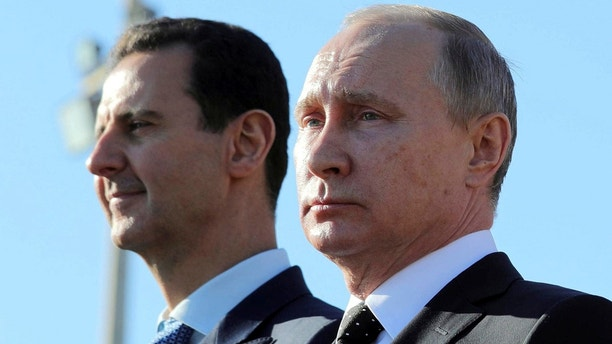 Russian President Vladimir Putin (R) and Syrian President Bashar al-Assad visit the Hmeymim air base in Latakia Province, Syria December 11, 2017. Picture taken December 11, 2017. To match Special Report RUSSIA-FLIGHTS/ Sputnik/Mikhail Klimentyev/ via REUTERS/File Photo  ATTENTION EDITORS - THIS IMAGE WAS PROVIDED BY A THIRD PARTY. - RC1DE7734AA0