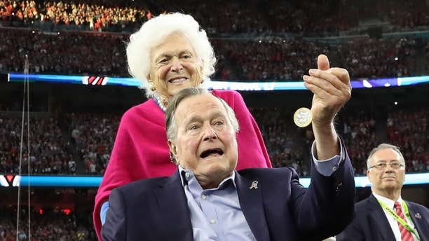 Former U.S. President George H.W. Bush participates in the coin toss ahead of the start of Super Bowl LI between the New England Patriots and the Atlanta Falcons as former first lady Barbara Bush looks on in Houston , Texas, U.S., February 5, 2017.  REUTERS/Adrees Latif   TPX IMAGES OF THE DAY - HT1ED251UD106
