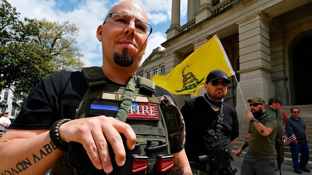 Shaun Baby, of Cartersville, Ga., participates in a gun-rights rally at the state capitol, Saturday, April 14, 2018, in Atlanta.  About 40 gun rights supporters have gathered for one of dozens of rallies planned at statehouses across the U.S. 