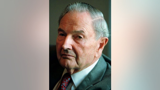 Business magnate David Rockefeller listens to a question at a press conference [attended by South African President Nelson Mandela following a meeting with Uniited States business leaders at Rockefeller Center in New York, September 18. Mandela told the press conference that he reserved judgement on the political crisis surrounding U.S. President Bill Clinton. ] - PBEAHUMGFDE