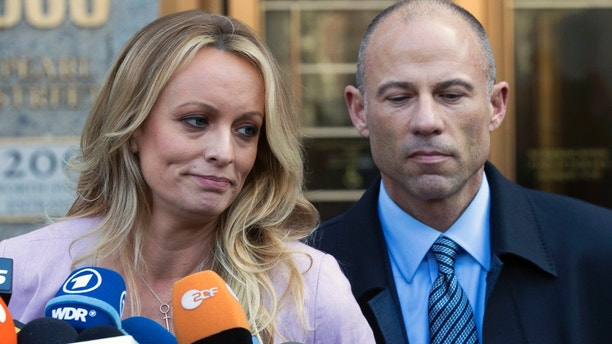 Adult film actress Stormy Daniels, left, stands with her lawyer Michael Avenatti as she speaks outside federal court, Monday, April 16, 2018, in New York. (AP Photo/Mary Altaffer)