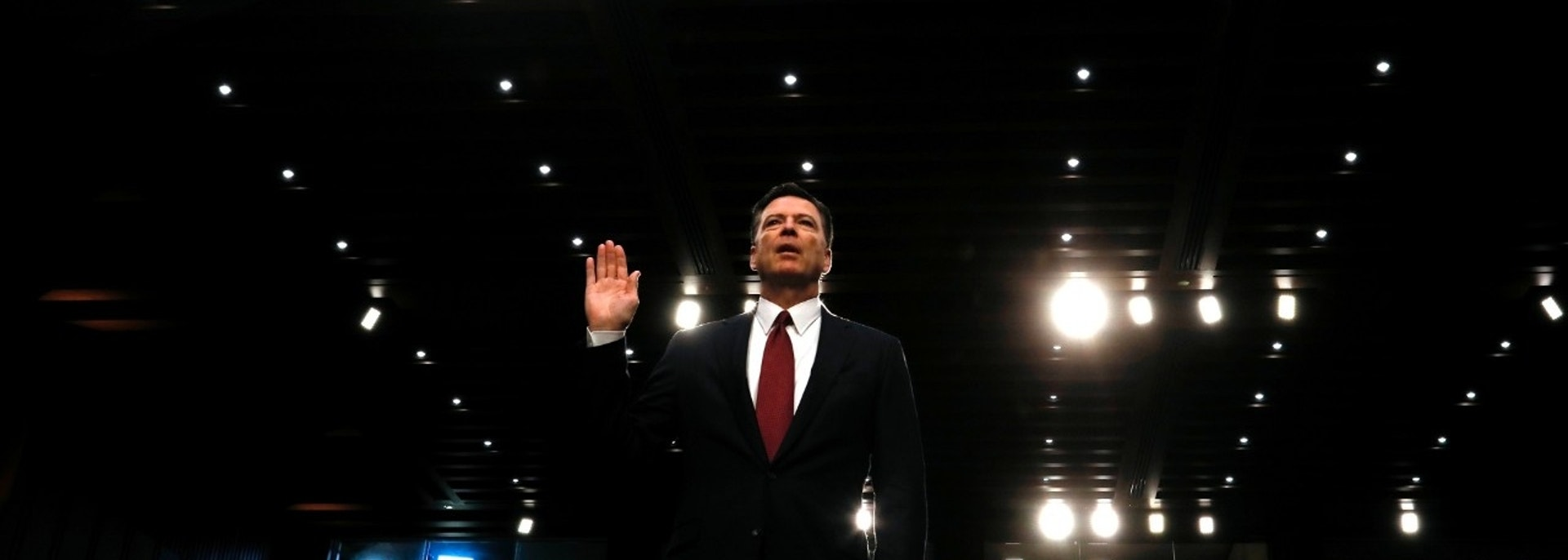 Former FBI Director James Comey is sworn in prior to testifying before a Senate Intelligence Committee hearing on Russia's alleged interference in the 2016 U.S. presidential election on Capitol Hill in Washington, U.S., June 8, 2017. REUTERS/Jonathan Ernst - HP1ED681D7GSU