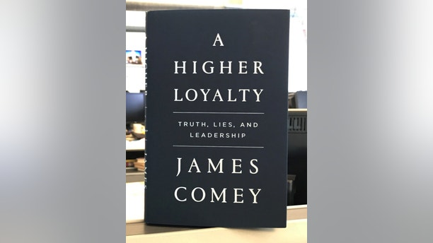 """A copy of former FBI director James Comey's book """"A Higher Loyalty"""" is seen in New York City, New York, U.S. April 13, 2018.  REUTERS/Soren Larson - RC131B5D4890"""