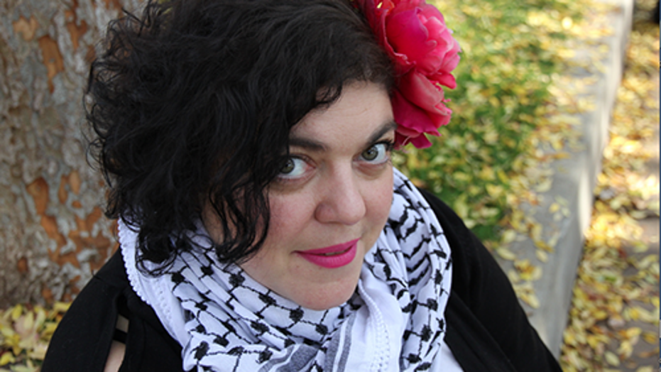 """Randa Jarrar, an author and professor at Fresno State's Department of English, sparked an uproar after calling the late Barbara Bush """"amazing racist"""" who raised a """"war criminal."""""""