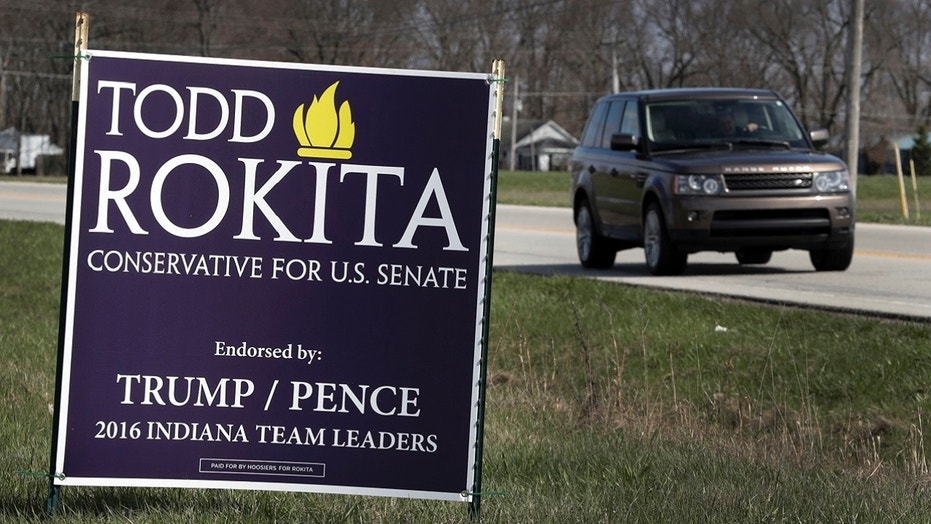A sign promoting the campaign of GOP Senate candidate Todd Rokita is shown along a state highway in Brownsburg, Ind., Tuesday, April 17, 2018. Donald Trump's re-election campaign has issued a rebuke to Rokita, ordering the Republican to take down yard signs that could give a false impression that Rokita is endorsed by the president, two officials with direct knowledge of the matter told The Associated Press.