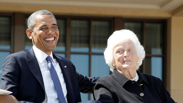 FILE PHOTO - U.S. President Barack Obama laughs alongside former first lady Barbara Bush during the dedication ceremony for the George W. Bush Presidential Center in Dallas, April 25, 2013. REUTERS/Jason Reed/File Photo - RC1FFA6EA3B0