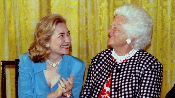 First lady Hillary Rodham Clinton (L) chats with former first lady Barbara Bush July 17 during an unveiling ceremony at the White House. Official White House portraits of Mrs. Bush and former President [George Bush] were unveiled during the ceremony - PBEAHUNCMAZ