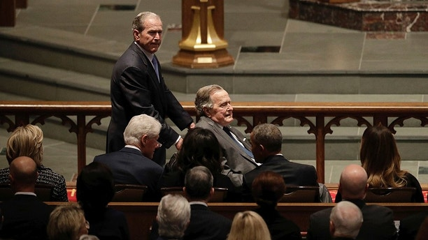 Former Presidents George W. Bush and George H.W. Bush arrive as they pass by former first lady Hillary Clinton, former President Bill Clinton, former first lady Michelle Obama, former President Barack Obama and first lady Melania Trump at St. Martin's Episcopal Church for a funeral service for former first lady Barbara Bush, Saturday, April 21, 2018, in Houston. (AP Photo/David J. Phillip )