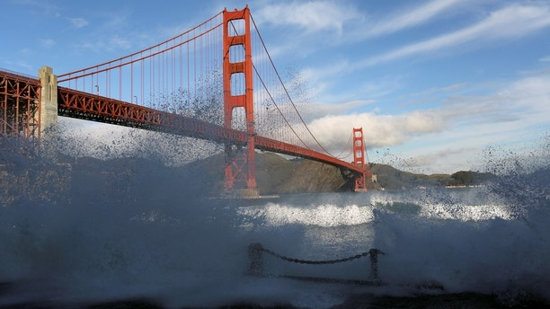 Waves crash against a sea wall in San Francisco Bay beneath the Golden Gate Bridge in San Francisco, California December 16, 2014.   REUTERS/Robert Galbraith/File Photo                      GLOBAL BUSINESS WEEK AHEAD PACKAGE    SEARCH BUSINESS WEEK AHEAD 10 OCT FOR ALL IMAGES - S1BEUGBZANAA