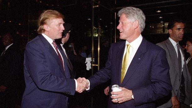 Donald Trump (L) greets then U.S. President Bill Clinton at a fundraiser in New York, U.S., in this June 16, 2000 handout photograph.      Courtesy William J. Clinton Presidential Library/Handout via REUTERS     ATTENTION EDITORS - THIS IMAGE WAS PROVIDED BY A THIRD PARTY. EDITORIAL USE ONLY. - HT1EC991NENKY