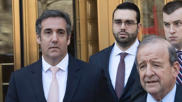 """Michael Cohen, left, President Donald Trump's personal attorney, leaves federal court in New York, Thursday, April 26, 2018. President Donald Trump said that Cohen, his personal attorney, represented him """"with this crazy Stormy Daniels deal,"""" after previously denying any knowledge of a payment Cohen made to the porn actress who alleges an affair with Trump.(AP Photo/Mary Altaffer)"""