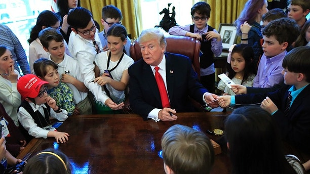 "President Donald Trump is surrounded by kids in the Oval Office in celebration of ""Bring Our Daughter and Sons to Work Day"" at the White House in Washington, Thursday, April 26, 2018. (AP Photo/Manuel Balce Ceneta)"