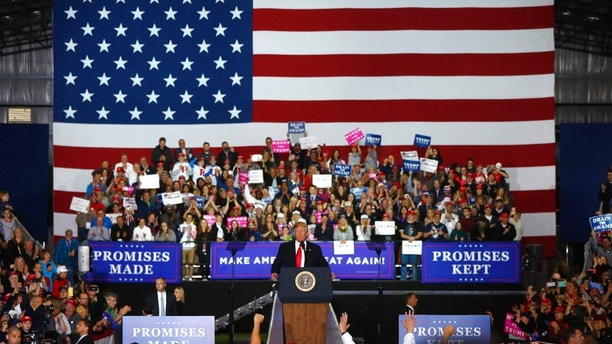 President Donald Trump speaks during a campaign rally in Washington Township, Mich., Saturday, April 28, 2018. (AP Photo/Paul Sancya)