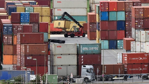 Containers are stored for export at a harbor in Duisburg, Germany, Monday, April 30, 2018.  (AP Photo/Martin Meissner)