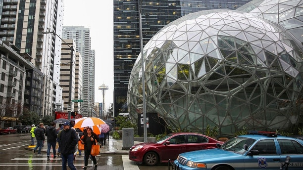 The Amazon Spheres are seen from Lenora Street, the Space Needle in the background, at AmazonÕs Seattle headquarters in Seattle, Washington, U.S., January 29, 2018.    REUTERS/Lindsey Wasson - RC15BBAE0BE0