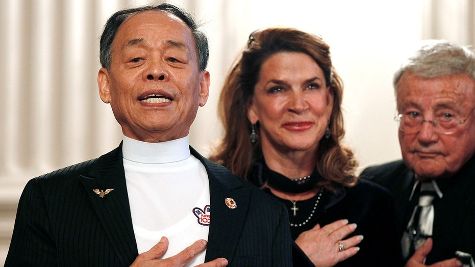 The U.S. Congressional Taekwondo Club celebrates the 80th birthday of Grand Master Jhoon Rhee, left, in 2010. He died on April 30 of this year in Arlington, Va.
