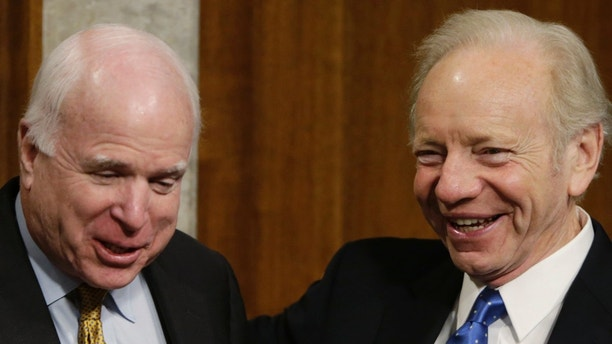 Senate Armed Services Committee Chairman John McCain (R-AZ) (L) jokes with Senator Angus King (I-ME) and former Senator Joe Lieberman (R) during a break