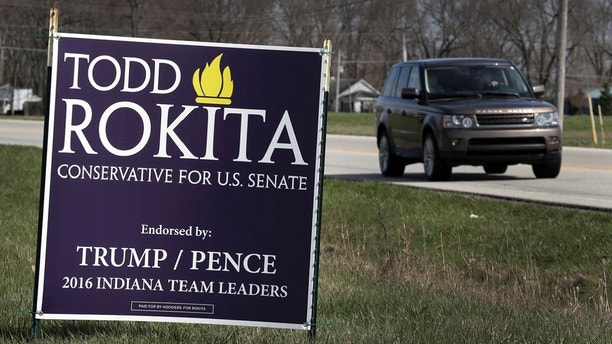 A sign promoting the campaign of GOP Senate candidate Todd Rokita is shown along a state highway in Brownsburg, Ind., Tuesday, April 17, 2018. Donald Trump's re-election campaign has issued a rebuke to Rokita, ordering the Republican to take down yard signs that could give a false impression that Rokita is endorsed by the president, two officials with direct knowledge of the matter told The Associated Press. (AP Photo/Michael Conroy)