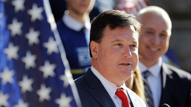 FILE- In this Aug. 9, 2017, file photo, Indiana Rep. Todd Rokita speaks during a news conference outside of the Indiana Statehouse in Indianapolis. Working for Rokita is an exacting job with long hours, made more difficult by a boss known for micromanaging and yelling at his staff, according to 10 former aides who spoke to The Associated Press. The lawmaker rejected the criticism and said he demands excellent from his staff and himself. (AP Photo/Darron Cummings, File)