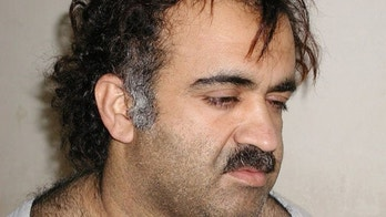 Khalid Sheikh Mohammed is shown in this file photograph during his arrest on March 1, 2003. Accused September 11 plotter Khalid Sheikh Mohammed is likely to be executed after being tried and convicted, White House spokesman Robert Gibbs said on January 31, 2010. The Obama administration has begun looking for places other than the heart of New York City to prosecute Mohammed and four alleged co-conspirators in the face of fierce criticism tied to security and costs.     REUTERS/Courtesy U.S.News & World Report/Files  (UNITED STATES - Tags: CRIME LAW CIVIL UNREST POLITICS)