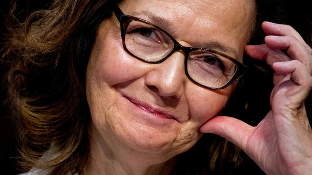 Gina Haspel, President Donald Trump's pick to lead the Central Intelligence Agency, smiles as she testifies at her confirmation hearing before the Senate Intelligence Committee, on Capitol Hill, Wednesday, May 9, 2018, in Washington. AP Photo/Andrew Harnik)