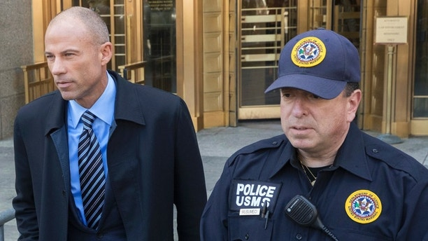Michael Avenatti, left, Stormy Daniels' attorney, leaves federal court in New York after a hearing for Michael Cohen, President Donald Trump's personal attorney, Thursday, April 26, 2018. (AP Photo/Mary Altaffer)