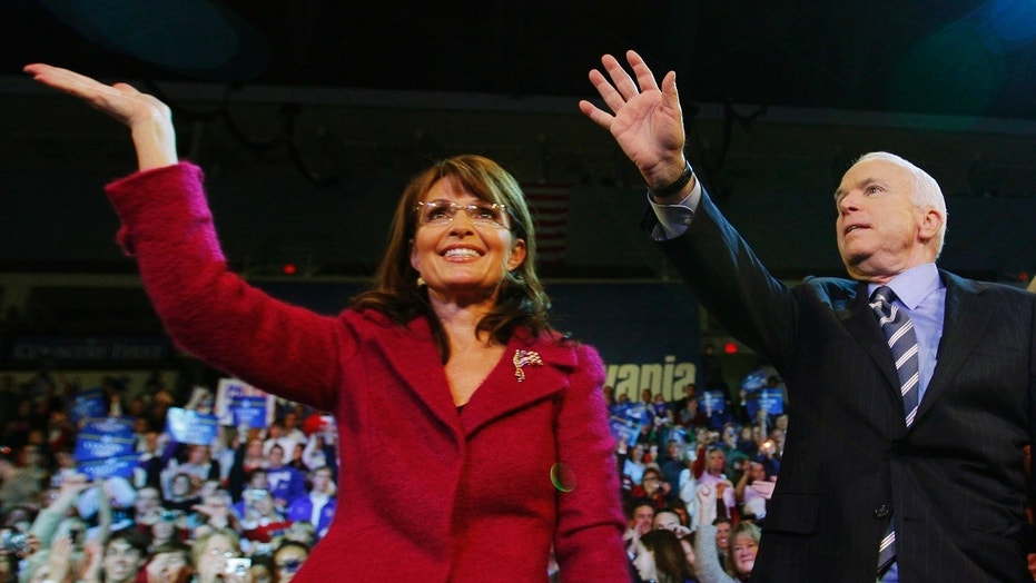 U.S. Republican presidential nominee Senator John McCain, R-Ariz., and U.S. Republican vice-presidential nominee Alaska Governor Sarah Palin wave to the crowd at a campaign rally in Hershey, Penn., October 28, 2008.