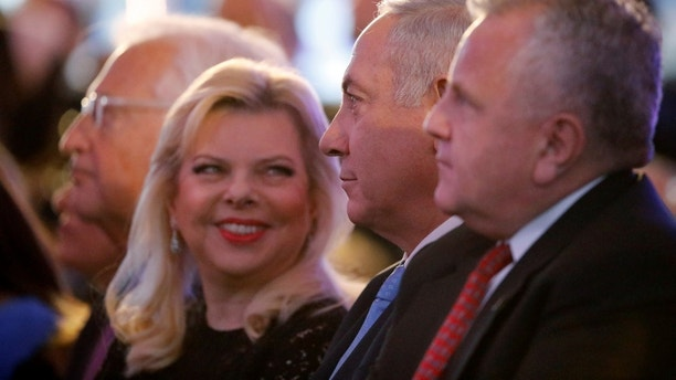U.S. Deputy Secretary of State John Sullivan, Israeli Prime Minister Benjamin Netanyahu and his wife Sara Netanyahu sit during a reception held at the Israeli Ministry of Foreign Affairs in Jerusalem, ahead of the moving of the U.S. embassy to Jerusalem, May 13, 2018. REUTERS/Amir Cohen - RC14D850B320