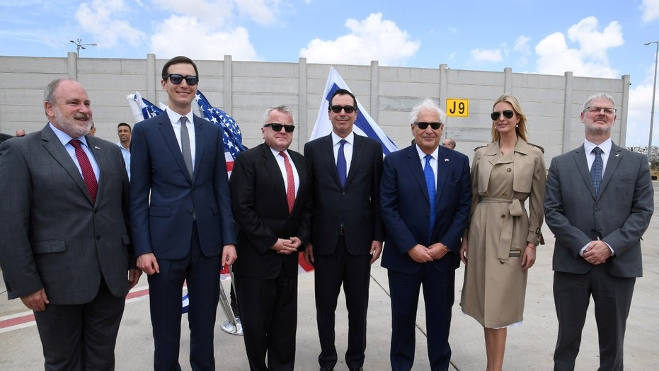 White House senior advisor Ivanka Trump (2nd-R), U.S. Ambassador to Israel David Friedman (3rd-R), U.S. Treasury Secretary Steven Mnuchin (C), U.S. Deputy Secretary of State John Sullivan (3rd-L), White House Senior Advisor Jared Kushner (2nd-L) and Israeli officials pose for a photo before the opening of the new U.S. embassy in Jerusalem.