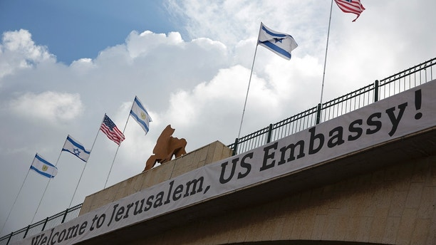 A sign on a bridge leading to the US Embassy compound ahead the official opening in Jerusalem, Sunday, May 13, 2018. Monday's opening of the U.S. Embassy in contested Jerusalem, cheered by Israelis as a historic validation, is seen by Palestinians as an in-your-face affirmation of pro-Israel bias by President Donald Trump and a new blow to frail statehood dreams. (AP Photo/Ariel Schalit)