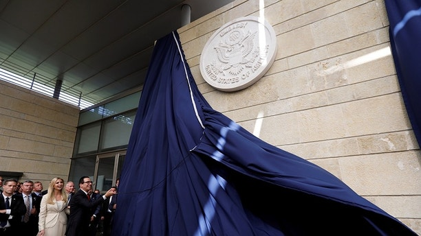 U.S. Treasury Secretary Steven Mnuchin unveils the seal for the new U.S. embassy, as he stands next to Senior White House Adviser Ivanka Trump during the dedication ceremony of the new U.S. embassy in Jerusalem, May 14, 2018. REUTERS/Ronen Zvulun - RC1A87064980