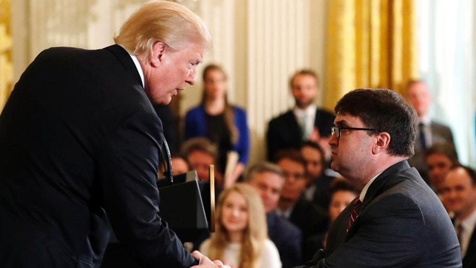 President Donald Trump shakes hands with Acting Veterans Affairs Secretary Robert Wilkie, during an event on prison reform in the East Room of the White House, Friday, May 18, 2018, in Washington. Trump announced he's nominating Acting Veterans Affairs Secretary Robert Wilkie to lead the agency.