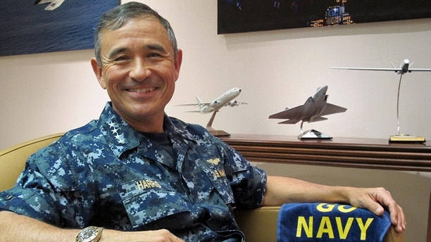 U.S. Pacific Fleet commander Adm. Harry B. Harris Jr. poses for a photo at his office in Pearl Harbor, Hawaii on Thursday, Dec. 12, 2013. Harris said the first overseas deployment of the USS Freedom, the Navy's newest ship, demonstrated the U.S. commitment to focus on the Asia and Pacific region while also teaching the Navy lessons about maintaining the vessel. (AP Photo/Audrey McAvoy)