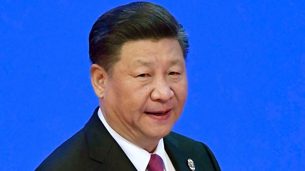 China's President Xi Jinping prepares to deliver his opening speech at the Boao Forum for Asia Annual Conference in Boao in south China's Hainan province, Tuesday, April 10, 2018. Xi promised to cut auto import taxes, open China's markets further and improve conditions for foreign companies in a speech Tuesday that called for international cooperation against a backdrop of a spiraling dispute with Washington over trade and technology. (Naohiko Hatta/Kyodo News via AP)