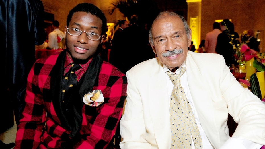 John Conyers III with his father, Rep. John Conyers, D-Mich., in 2011.