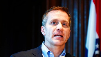 FILE - In this April 11, 2018, file photo, Missouri Gov. Eric Greitens speaks at a news conference in Jefferson City, Mo., about allegations related to his extramarital affair with his hairdresser. A lawyer for Greitens is arguing at a court hearing, Thursday, April 26, 2018, that Attorney General Josh Hawley should be barred from investigating the governor because of critical comments potentially motivated by Hawley's candidacy for the U.S. Senate. (Julie Smith/The Jefferson City News-Tribune via AP, File)