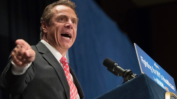 """FILE - In this July 17, 2017 file photo, New York Gov. Andrew Cuomo speaks during a rally in support of the Affordable Care Act and against a Senate replacement bill, in New York. In the already tense New York governor's primary race between the two-term incumbent and openly gay """"Sex and the City"""" star Cynthia Nixon, there's one issue on which the two Democrats unquestionably share common ground and deep histories: gay rights. (AP Photo/Mary Altaffer, File)"""