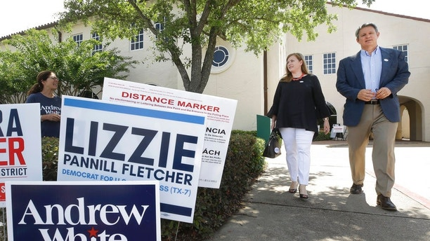 Lizzie Pannill Fletcher, a Democrat candidate for the 7th Congressional District, and her husband, Scott Fletcher, leave after voting in the primary runoff at St. Anne's Church, Tuesday, May 22, 2018, in Houston. (Melissa Phillip/Houston Chronicle via AP)