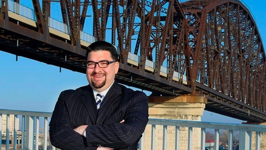 In this 2018 photo provided by Alvarez for Judge, Louisville lawyer Danny Alvarez poses for a photo in Louisville, Ky. Alvarez, 43, has died one day after advancing in a primary election in a judicial race. Family friend and campaign consultant Jonathan Hurst said in an email that Danny Alvarez died Wednesday, May 23, 2018. (Alvarez for Judge via AP)