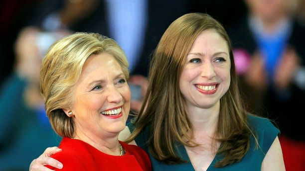 Democratic presidential nominee Hillary Clinton shares a hug with her daughter Chelsea Clinton at a campaign rally in Raleigh, North Carolina November 8, 2016. REUTERS/Chris Keane - D1BEULPIVQAA