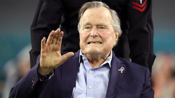 FILE PHOTO -  Former U.S. President George H.W. Bush arrives on the field to do the coin toss ahead of the start of Super Bowl LI between the New England Patriots and the Atlanta Falcons in Houston, Texas, U.S., February 5, 2017. REUTERS/Adrees Latif/File Photo - RC14257F6DD0