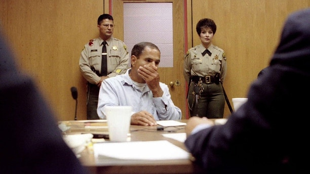 Sirhan Sirhan listens as the parole board (foreground) gives him the reasons it is denying him parole at his tenth parole hearing at the Corcoran State Prison in Corcoran, California June 18. Sirhan was convicted of slaying Sen. Robert Kennedy.  USA SIRHAN - RP1DRICWUPAA