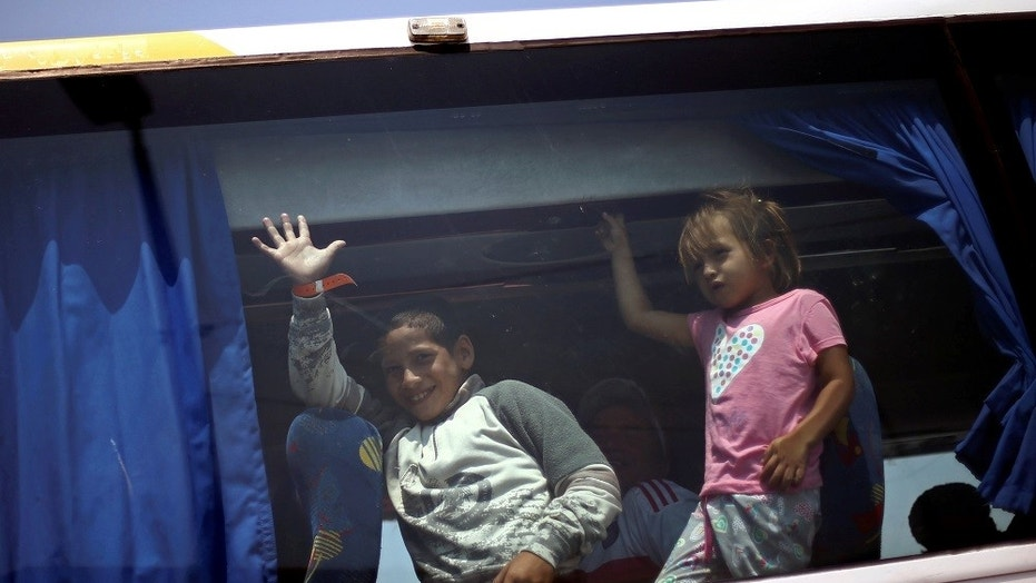 Migrant children from Central America arrive in a caravan at a temporary shelter set up for them by the Roman Catholic church, in Mexico City, April 9, 2018.