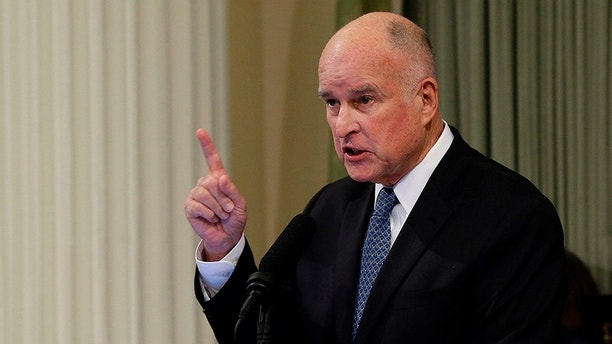 """FILE - In this Jan. 25, 2018 file photo, California Gov. Jerry Brown delivers his annual State of the State address before a joint session of the Legislature in Sacramento, Calif. President Donald Trump slammed Brown's posture on sending National Guard troops to the Mexican border Tuesday, April 17, 2018, even as Brown said he was nearing agreement on joining the president's mission and that his troops were """"chomping at the bit ready to go."""" (AP Photo/Rich Pedroncelli, File)"""