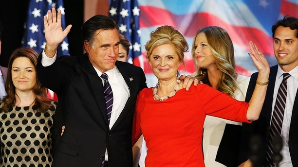 Republican presidential nominee Mitt Romney stands on stage with his wife Ann after he delivered his concession speech during his election night rally in Boston, Massachusetts, November 7, 2012.        REUTERS/Mike Segar (UNITED STATES  - Tags: POLITICS ELECTIONS USA PRESIDENTIAL ELECTION)   - TB3E8B70IEFPN