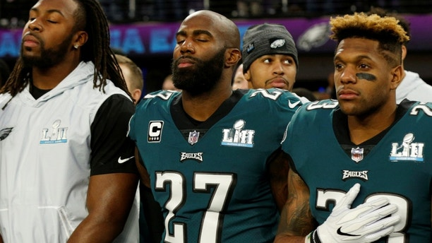 NFL Football - Philadelphia Eagles v New England Patriots - Super Bowl LII - U.S. Bank Stadium, Minneapolis, Minnesota, U.S. - February 4, 2018  Philadelphia EaglesÕ Rodney McLeod and Malcolm Jenkins during the national anthems before the game   REUTERS/Kevin Lamarque - RC121AA87880