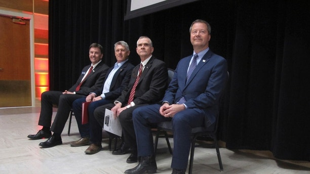 FILE -This Thursday, March 22, 2018 file photo shows the four Republican candidates for U.S. Senate prior to a debate Montana State University on, in Bozeman, Montana. From left, Russell Fagg, Troy Downing, Matt Rosendale and Al Olszewski are competing for the chance to challenge Democratic Sen. Jon Tester this fall. (AP Photo/Matt Volz, File)
